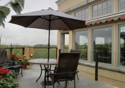 Residential outdoor patio with table and umbrella