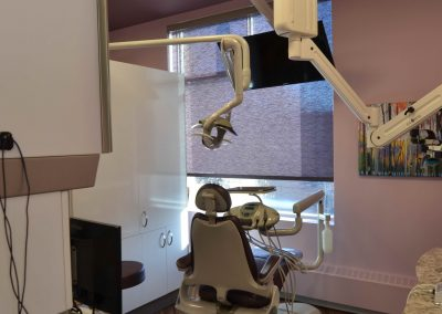 Violet walls and matching violet window covers in dental operatory