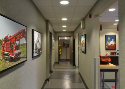 Commercial office hallway with grey and red accents