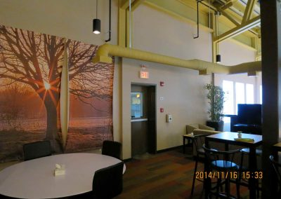 Open communal seating area with wall decoration of sunset