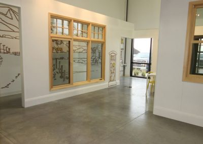 Commercial window showroom with white walls and windows