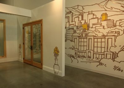 Showroom with sketched murals and yellow accents