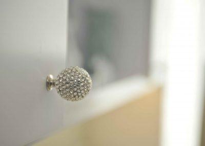 Swarovski crystal knob on white cabinet