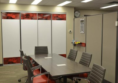 Private boardroom with meeting table and chairs