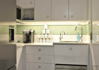 Staff kitchen space with custom white cabinets