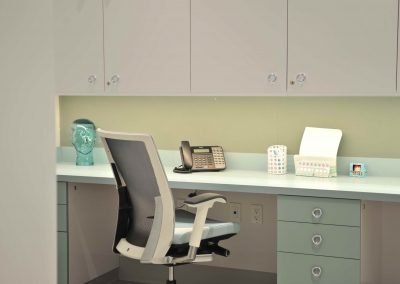 Custom built in mint and white desks at dental clinic