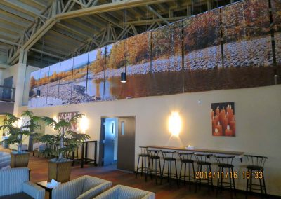 Large mural of river and trees as focal point of room