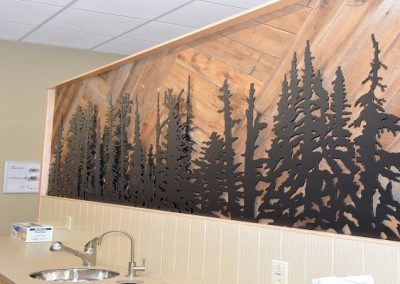 Custom wooden wall design with forest of trees