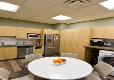 Commercial kitchen staffroom with seating area and washing machines