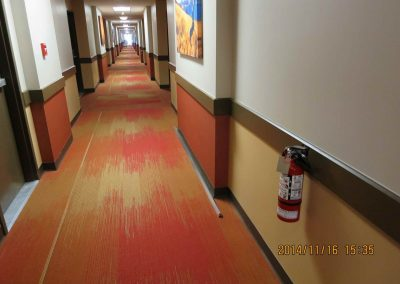 Commercial office hallway with geometric yellow and red carpet