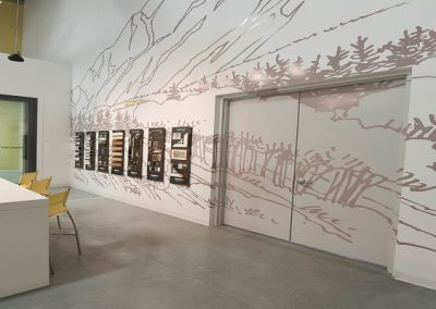 Large showroom wall with sketch mural