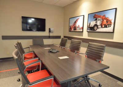 Commercial boardroom with custom red office chairs