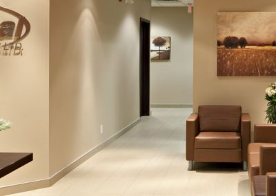 Hallway into reception area with waiting room of commercial office space