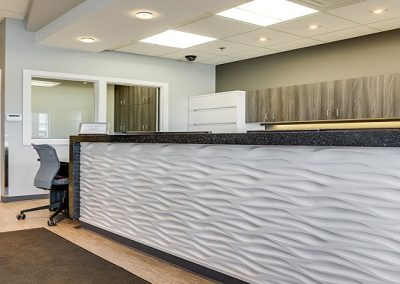Custom designed white textured reception desk