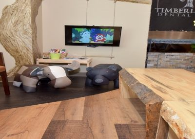 Custom designed wooden coffee table with wooden hardwood floors in waiting room