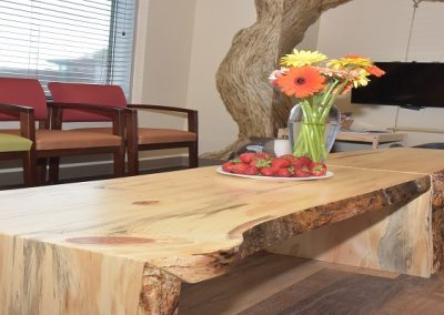 Custom wooden coffee table in dentist office waiting room