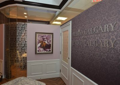 Violet damask wallpaper in front entrance of perio clinic