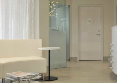 Modern dental reception area with curved white booth seating