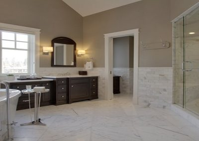 Large ensuite master bathroom with white soaker tub