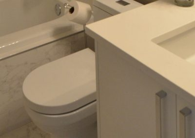 White bathroom counter top and matching white quartz tiles