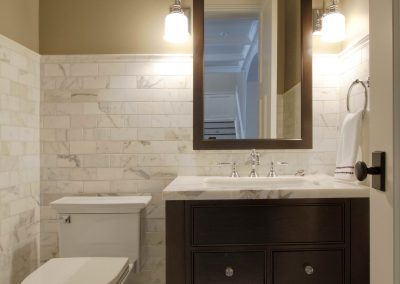 White backsplash and white features in powder room