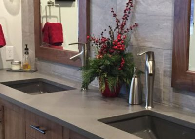 Grey bathroom countertops and his and her sinks