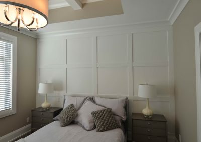 Built in wall custom headboard with grey bed
