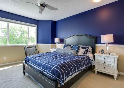 Blue and white interior styled bedroom