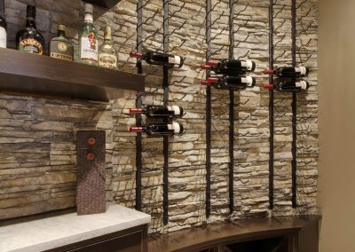 Home bar with rock wall accent and wine rack