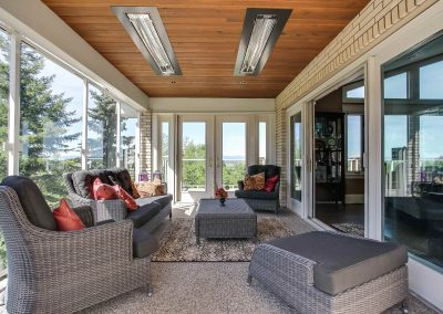 Sunroom with built in ceiling heaters above seating area