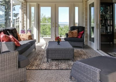 Sunroom with patio furniture for entertaining guests