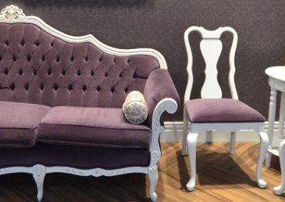 Mauve and white traditional style furniture in waiting room