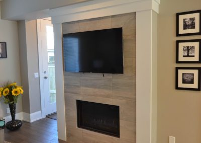 Residential Entertainment Space 13 Narrow Fireplace with TV Above Fireplace