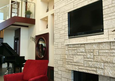 Residential Entertainment Space 14 Tyndall Stone Fireplace with TV Above Fireplace