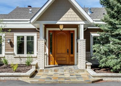 Front entrance of home with large wooden door