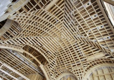 Arched wooden framed ceiling details being built