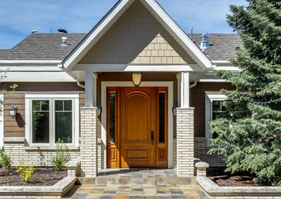 Wooden front door leading into home