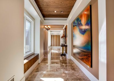 Marble floors leading through hallway at front entrance of home