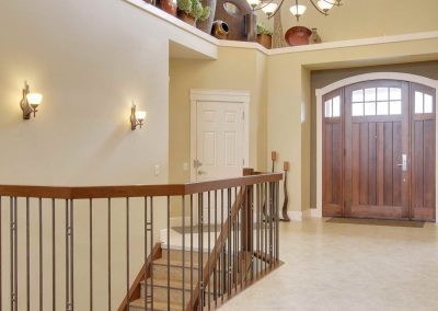 Foyer from front door leading into open hallway