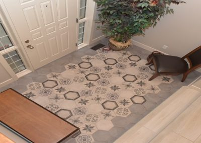 Front door foyer with pentagon shaped floor tile