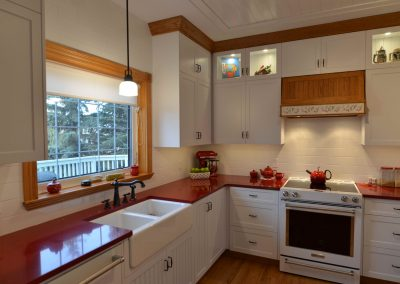 Farmhouse kitchen renovation with custom white cabinets