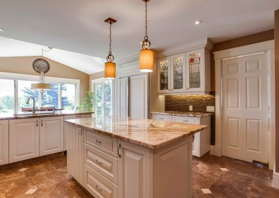 Custom kitchen renovation with quartz island and white cabinets