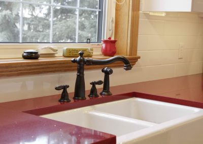 Red kitchen coutner tops in country styled kitchen